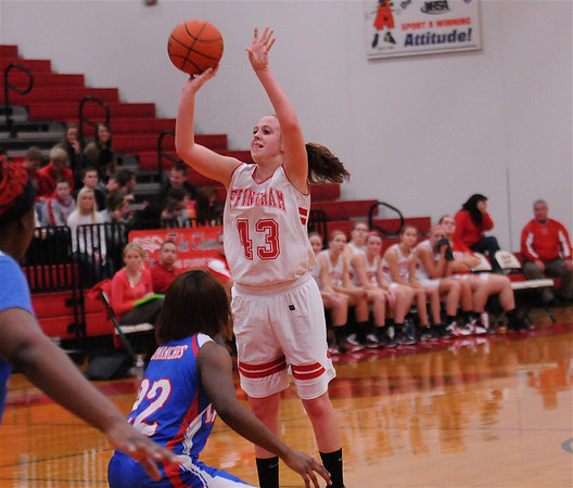 Effingham's Josie Zerrusen shoots a jumper in the first half of the Hearts' win against Cahokia on Friday.  Zerrusen finished with a game-high 20 points.