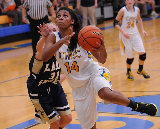 CHBC's Micah Jones spins toward the hoop for a basket in her team's 52-44 loss to Teutopolis.