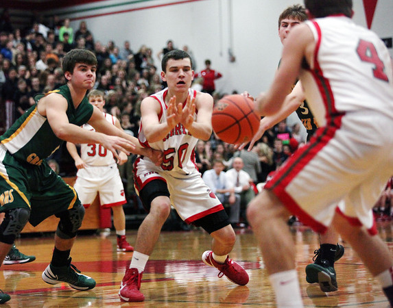 Alex Carie (4) and Clark Williamson (50) make a pass against Mattoon. Carie scored 10 points in the Hearts' 53-39 win over the Green Wave.