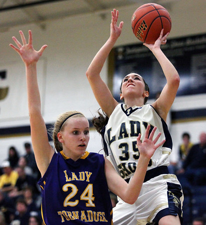 Teutopolis' Cierra Thompson goes for a lay-up during the Wooden Shoes' 40-32 victory against the Taylorville Tornadoes. Thompson scored 20 of the team's points.