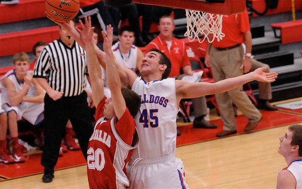 St. Anthony's John Goeckner grabs one of his game-high 12 rebounds. Goeckner also had 21 points, but Vandalia managed to rally in the fourth quarter to a 70-65 win on the opening day of the Vandalia Holiday Tournament.