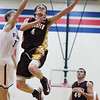 Dieterich's Dalton Hinterscher drives in for a lay up during the Movin' Maroons' win against St. Anthony at St. Anthony High School.