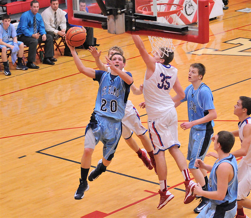St. Elmo's Levi Maxey drives past St. Anthony's Alex Hoelscher (35) for a layup attempt at the Enlow Center. Maxey scored 17 points, but the Eagles fell, 55-44.