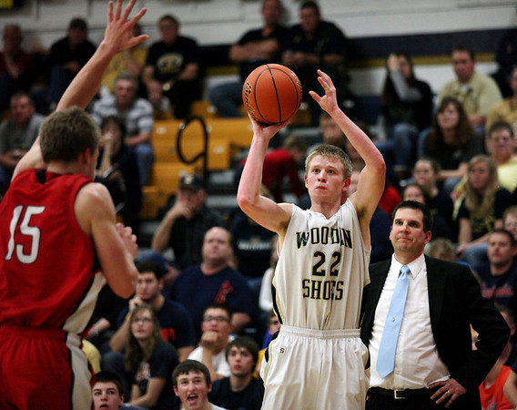 Teutopolis's Reed Hardiek searches for a shot Tuesday during the Wooden Shoes' 45-48 home loss against Highland as coach Andy Fehrenbacher looks on.