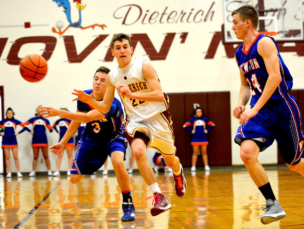 Newton's Brock Mammoser strips the ball from Dieterich's Alex Bohnhoff during the Dieterich Holiday Tournament finals.