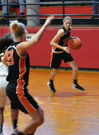 Altamont's Lily Laatsch dribbles toward the basket while Gabby Alwardt (50) posts up against Dieterich's Rachel Schmidt at the NTC Tournament.