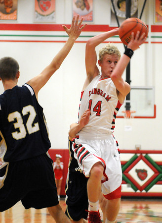 Effingham's Kennan Mahaffey slips around the defense of Teutopolis' Justin Kenter.