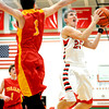 Effingham's Grant Wolfe skies for a layup and avoids a Charleston defender during the Effingham-Teutopolis Christmas Classic.