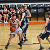 Altamont's Justin McGinnis makes his way into the lane amid a sea of South Central defenders.