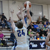 South Central's Noah Powless rises up for a shot while being defended by Okaw Valley's Justin Vanderburgh (24).