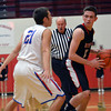 Beecher City's Adam Doty is guarded closely by St. Anthony's Matt Gibson.