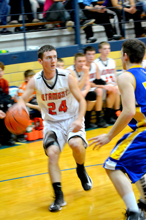 Altamont's Aaron Goeckner dribbles into the lane against Cowden-Herrick at the St. Elmo Holiday Tournament.