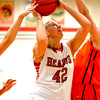 Effingham's Stephanie Robb takes the ball up toward the basket despite the defense of two Paris Lady Tigers.