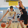 Cumberland's Trevor Beard dribbles the ball upcourt while being defended by Altamont's Garrett Ziegler.