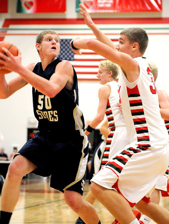 Teutopolis' Brett Mette makes a move in the post in an attempt to shake the defense of Effingham's Isaac Foreman during the Effingham-Teutopolis Christmas Classic championship game.