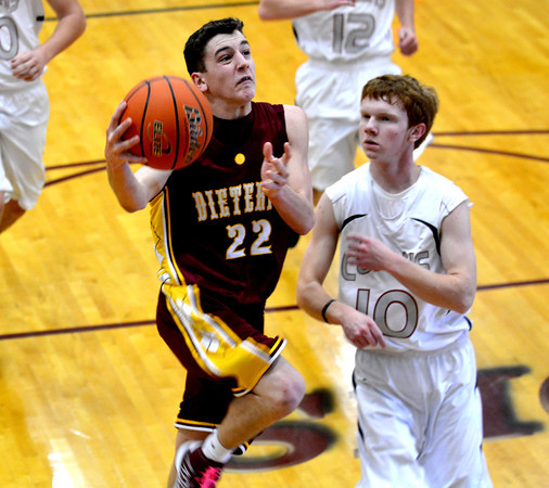 Dieterich's Alex Bohnhoff goes for a layup while being trailed by a Centralia Christ Our Rock Lutheran defender at the Dieterich Holiday Tournament.