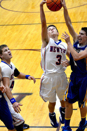 Newton's Brock Mammoser blocks a shot during the Eagles' win over Oblong at the Dieterich Holiday Tournament.