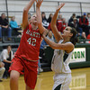Effingham's Stephanie Robb goes up for a layup while being fouled by a Mattoon defender.