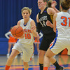 Newton's Lexie Davidson dribbles around a screen from teammate Andrea Cartright on Casey-Westfield's Chelsea Cox.
