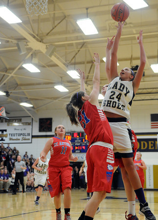 Teutopolis' Haley Giles goes for a layup over St. Anthony's Abby Brown.