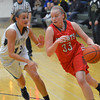 Effingham's Caitlin Kaufman takes the ball to the basket and drives past Mattoon's Shelby Cox.