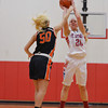 St. Anthony's Megan Nuxoll shoots a jump shot over the defense of Altamont's Gabby Alwardt.
