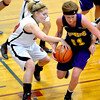 North Clay's Morgan Walker attempts to steal the ball from Brownstown/St. Elmo's Bethany Oberlink at the Dieterich Holiday Tournament.