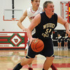 Teutopolis' Ryan Sandschafer takes the ball to the hole during the Wooden Shoes' 44-41 win over Effingham.