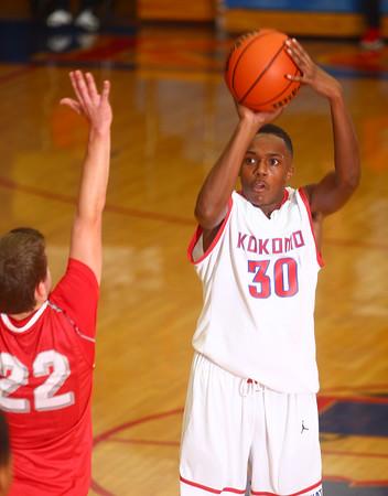 12-6-14<br /> Kokomo vs Fishers basketball<br /> Brevin Beard puts the ball up to the net.<br /> Kelly Lafferty Gerber | Kokomo Tribune