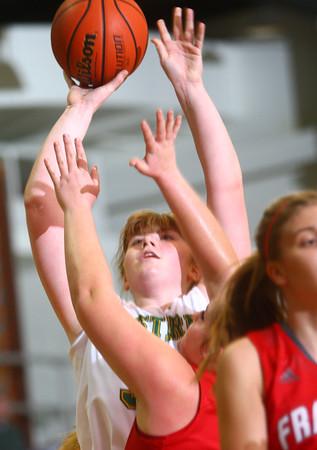 12-2-14<br /> Eastern girls basketball<br /> Hailey Holliday shoots over a Frankton player.<br /> Kelly Lafferty Gerber | Kokomo Tribune