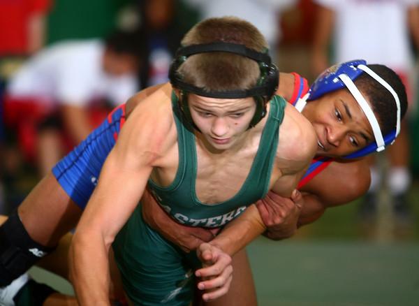 12-3-14<br /> Eastern vs Kokomo wrestling<br /> Kokomo's Jabin Wright and Eastern's Aren Turner. Wright won the match.<br /> Kelly Lafferty Gerber | Kokomo Tribune