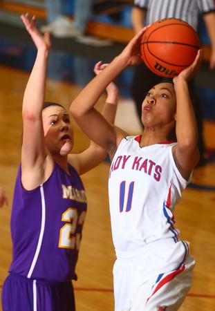 12-19-14<br /> Kokomo vs Marion basketball<br /> Kokomo's Quaynika Merriweather shoots over Marion's Julia Cardwell.<br /> Kelly Lafferty Gerber | Kokomo Tribune