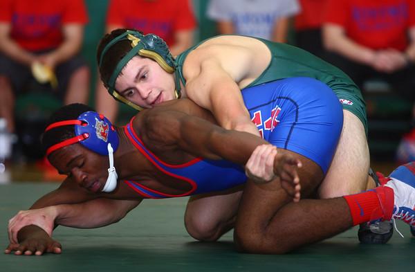 12-3-14<br /> Eastern vs Kokomo wrestling<br /> Kokomo's DaShaun Barbary and Eastern's Andrew Turner. Turner won the match.<br /> Kelly Lafferty Gerber | Kokomo Tribune