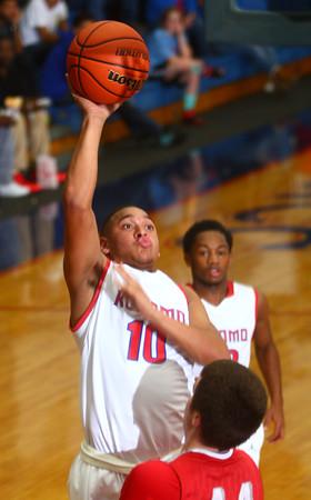 12-6-14<br /> Kokomo vs Fishers basketball<br /> Kokomo's Jordan Rawlins shoots.<br /> Kelly Lafferty Gerber | Kokomo Tribune