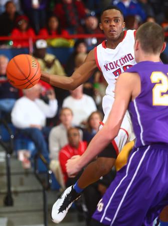 12-19-14<br /> Kokomo vs Marion basketball<br /> Kokomo's Brevin Beard passes.<br /> Kelly Lafferty Gerber | Kokomo Tribune