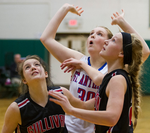 St. Anthony's Emma Richards watches as her shot goes in against Sullivan at the Mattoon Holiday Tournament.<br /> Keith Stewart photo/For the Daily News