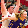 Effingham's Shelby Myers surrounds Taylorville's Peyton Jackson.<br /> Keith Stewart photo/For the Daily News