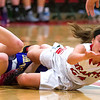 Effingham's Miranda Fox scrambles for the ball in what was a physical contest against Taylorville.<br /> Keith Stewart photo/For the Daily News