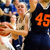 Teutopolis' Anna Hartke tries to get around Carterville's Cora Gurrieri.