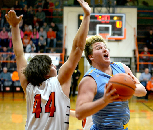 Cumberland's Mike Wolke makes a move around the defense of Altamont's Evan Cornett.