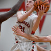 Effingham's Trevor Kreke goes for a layup between two Mattoon defenders Friday evening at Effingham High School.