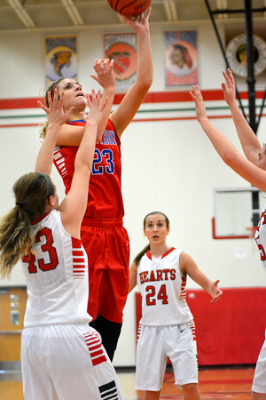 St. Anthony's Olivia Clausius puts up a hook shot over the defense of Effingham's Bria Barr (43) as Miranda Fox (24) looks on from the background.