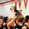 The Teutopolis Wooden Shoes lift their trophy after winning the Effingham-Teutopolis Christmas Classic.