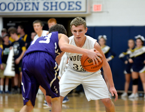 Teutopolis' Chris Ungrund applies pressure to Breese Central's Karson Fehrmann during the Wooden Shoes' Homecoming win.