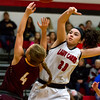 Dieterich's Gracie Britton's shot is blocked by North Clay's Taylor Jones, right. The Lady Cardinals landed several blocks with Jones earning the lion's share. She also led the team in scoring with 26 points as North Clay defeated the Maroons 47-37.
