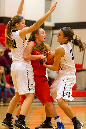 Teutopolis' Sadie Bueker, left, guards Flora's Skylar Freeman while Raegan Drees, right, steals the ball in Fairfield.