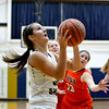 Teutopolis' Raegan Drees looks up and prepares to release a game-winning, buzzer-beating layup in Teutopolis' 55-53 win over Pana.