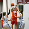 Newton's Kaitlyn Cohorst puts up a jumper against two Arcola defenders at the Dieterich Holiday Tournament.