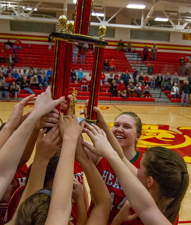 Effingham's Shelby Myers, right, smiles as she and her teammates grab hold of the 2016 Charleston Holiday Tournament championship trophy after defeating the host 59-52.