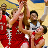 Effingham's Mason Hull (23) and Landon Wolfe, right, vie for a rebound along with Northwest Academy of Law's Jamarr Wiliams, who finished with 27 points and 13 rebounds.